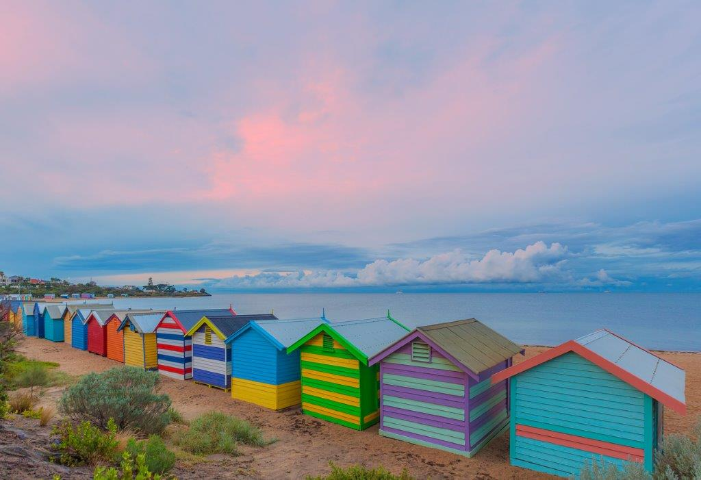 colourful bathing boxes at sunset