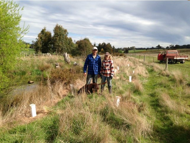 Landholders at Little Coliban River surrounded by revegetation.