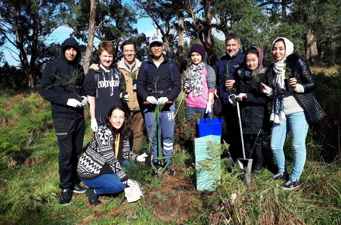 Ucan2 Centre for Multicultural Youth students at a tree planting event on one of the participating properties.