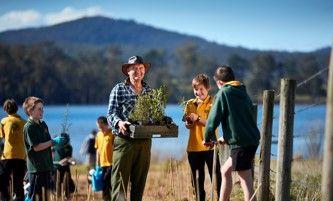 School kids planting trees icon